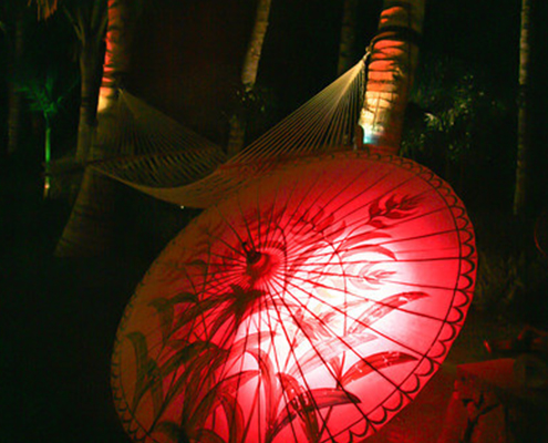 Parasol with red back lighting and hammock
