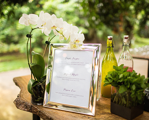 Wedding reception bar menu with orchids
