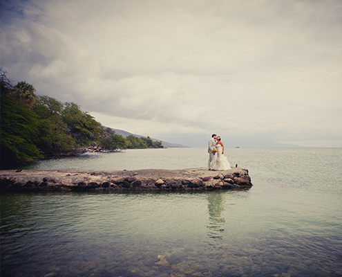 Bride & Groom on stone jetty in Olowalu Maui