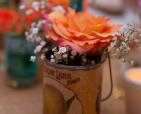 floral arrangement in antique tin can