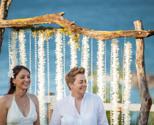 curtain of fresh flowers on rustic branch wedding arch