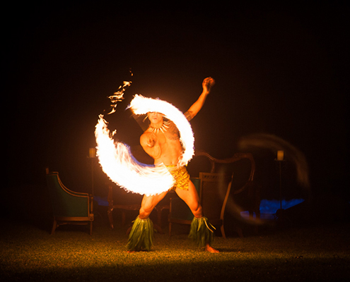 Hula dancer performs with fire