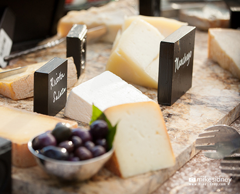 Assortment of cheeses with black signs
