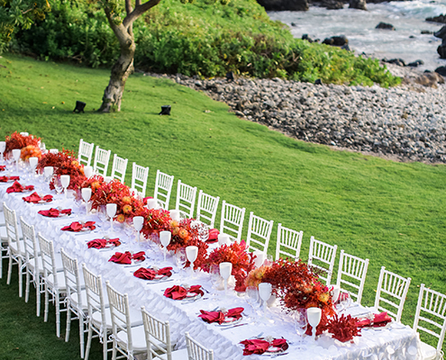Colin Cowie Rehearsal Dinner Table Setup with Red Coral