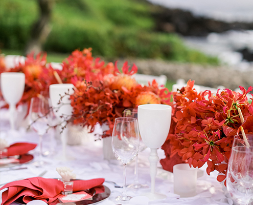 Colin Cowie Rehearsal Dinner Table Setting with Red Coral